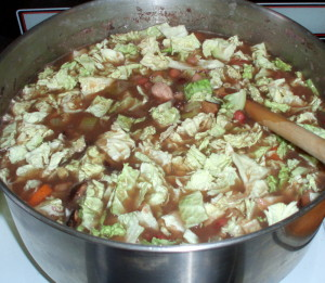 Bean soup with cabbage being added