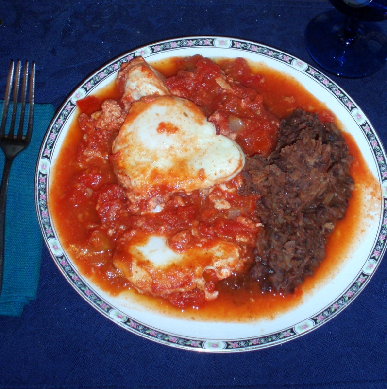 Eggs in Tomatoes with Refried Beans - Inhabited Kitchen