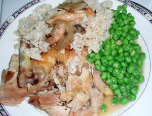 Chicken and sauce, served with rice and peas - Inhabited Kitchen