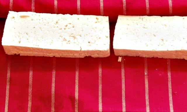 Slabs of tofu on a towel, to remove water.