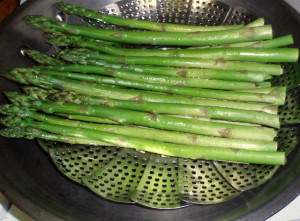 Steaming asparagus spears - www.inhabitedkitchen.com