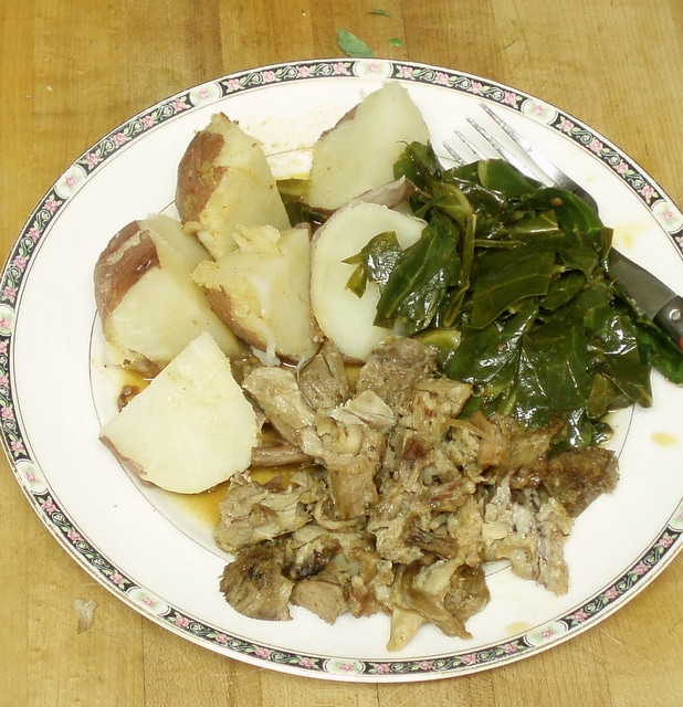 Collard greens with potatoes and pork - www.inhabitedkitchen.com