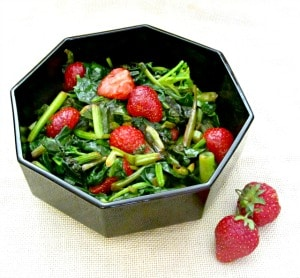 Sweet red strawberries nestled in savory sauteed spinach - a wonderful vegetable dish to celebrate the beginning of summer!