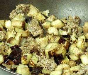 Adding meat to browned eggplant - www.inhabitedkitchen.com