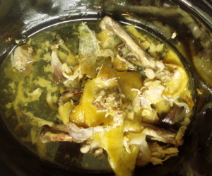 Bones and scrap returned to slow cooker - www.inhabitedkitchen.com