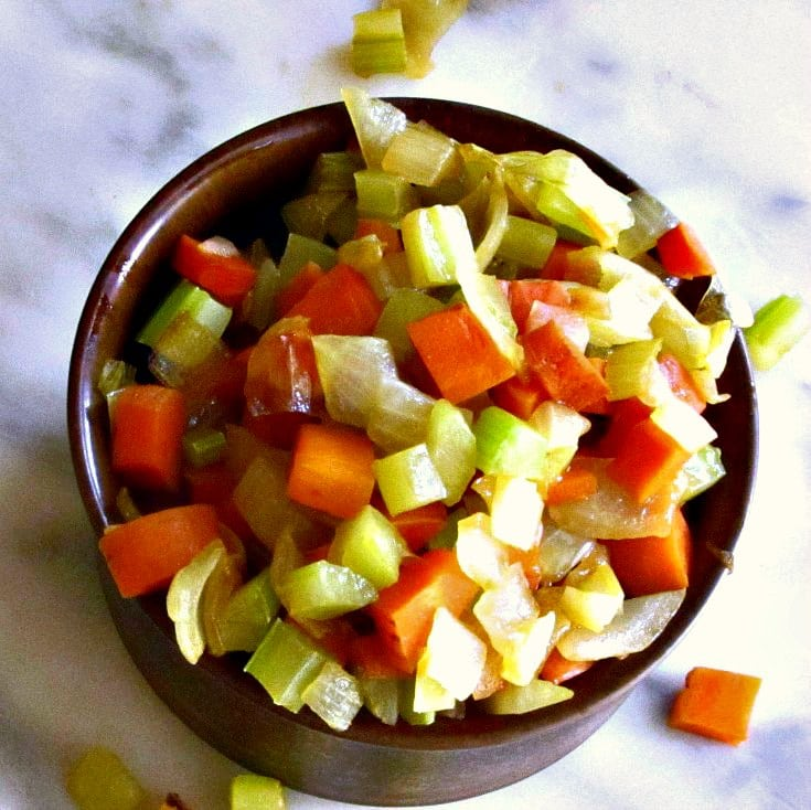 A dish of prepared mirepoix, ready to use in a recipe.