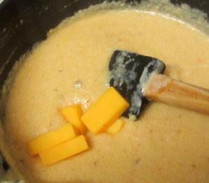 Adding cheese to thickened sauce - www.inhabitedkitchen.com