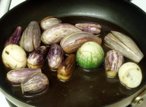 Simmering eggplant - www.inhabitedkitchen.com