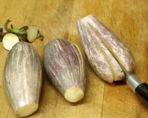 Slicing eggplant into fans - www,inhabitedkitchen.com