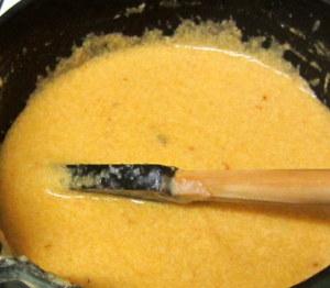 Stirring chipotle cheese sauce - www.inhabitedkitchen.com