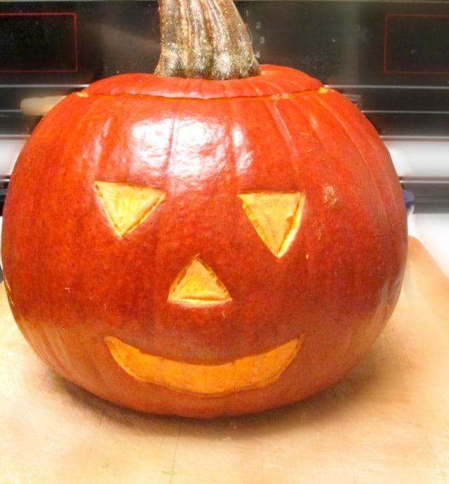 Make a Jack o'Lantern Roast Sutuffed Pumpkin, for a perfect festive Halloween dinner!