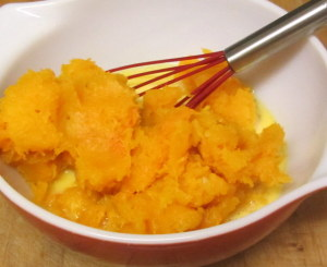 Beating cooked squash into eggs - www.inhabitedkitchen.com