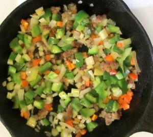 Sausage and aromatics for cornbread - www.inhabitedkitchen.com