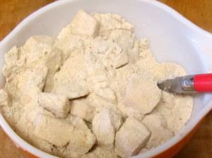 Tossing apple pieces in flour mixture - www.inhabitedkitchen.com