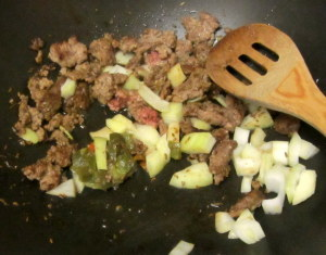 Saute meat, peppers and onion - wwww.inhabitedkitchen.com