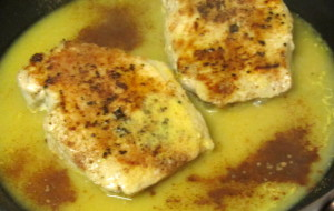 Adding orange juice and cinnamon to browned, spiced pork chops - www.inhabitedkitchen.com