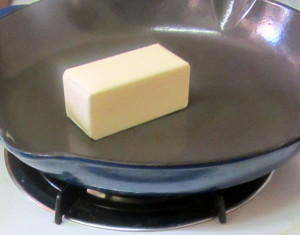 Melting butter in a heavy pan, for even heat, to make roux - www.inhabitedkitchen.com