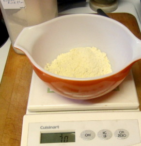 Weighing gf flour - www.inhabitedkitchen.com