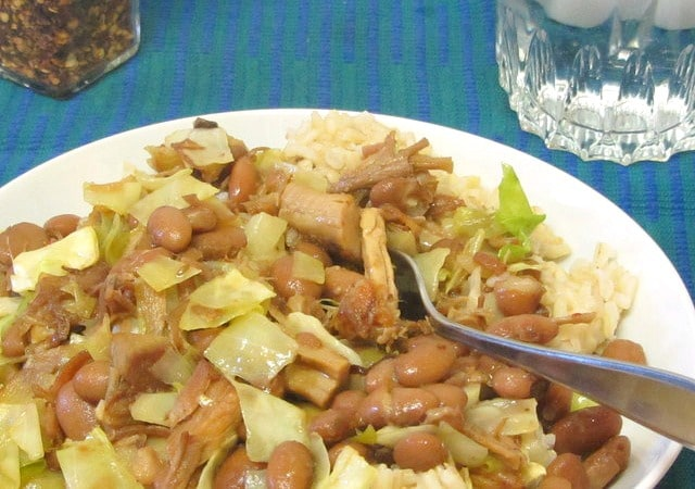 Add pintos and cabbage to slow cooked pork - www.inhabitedkitchen.com
