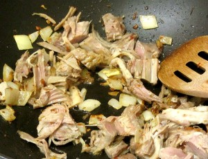 Saute onion, seasoning, and pork - www.inhabitedkitchen.com