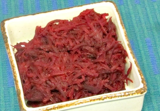 Shred beets and saute them in butter - with a little orange juice to brighten them - for a lighter feeling vegetable - www.inhabitedkitchen.com