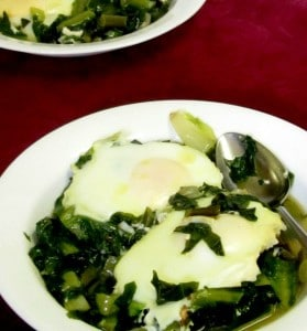 Simmer greens in broth and cook your eggs nestled right in them for a quick and easy meal of greens and eggs. www.inhabitedkitchen.com
