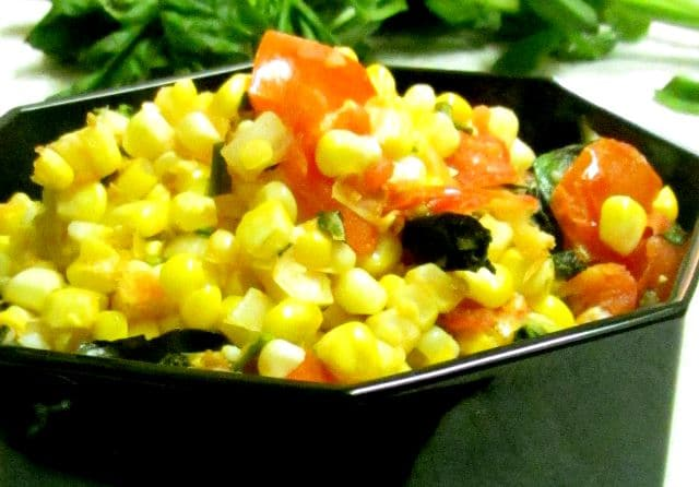 Very lightly saute fresh corn and tomatoes for a delicious and easy vegetable recipe that tastes like summer. www.inhabitedkitchen.com