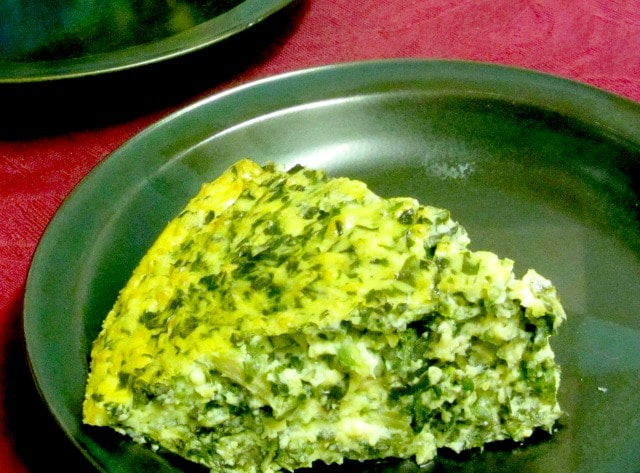 Use cooked chard - or other greens - to make a chard crustless quiche. Serve hot or cold, lunch or dinner! www.inhabitedkitchen.com