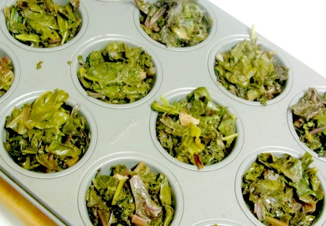 Freeze cooked greens - leftover or cooked for the purpose - in muffin tins, for convenient single serving sized pieces. www.inhabitedkitchen.com