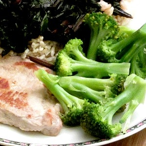 WIAW 86 - Dinner - Pork Chop, broccoli, beet greens over rice.