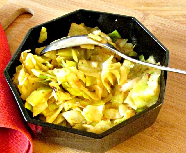 Simple sauteed cabbage with Harissa - a North African combination of hot peppers and spices, that adds both heat and complex flavor.