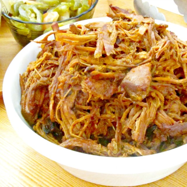 Make this easy slow cooker pulled pork with a smoky spicy sauce made of chipotle in adobo.