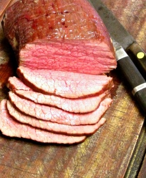 Slow Roast Beef is a method to roast tougher cuts of beef such as round with a lower temperature to make beautiful tender roast beef.