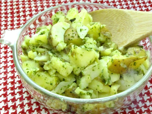 Potato salad made with an herbed oil and vinegar dressing - excellent for lunch boxes, picnics, and anyplace you want a lighter salad - and no mayo!