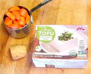 Use silk tofu to make this creamy, vegan carrot ginger salad dressing. Lovely with a tossed salad, a grain based salad, or as a dip.