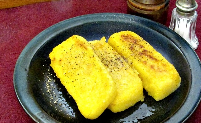 Polenta is easy to make at home. You can either eat it all at once, or cool, slice, and keep it to reheat later when you need a quick, easy meal.