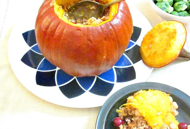 A vegan Stuffed Pumpkin gives everyone an impressive dish to serve at a Thanksgiving dinner - or for Halloween!