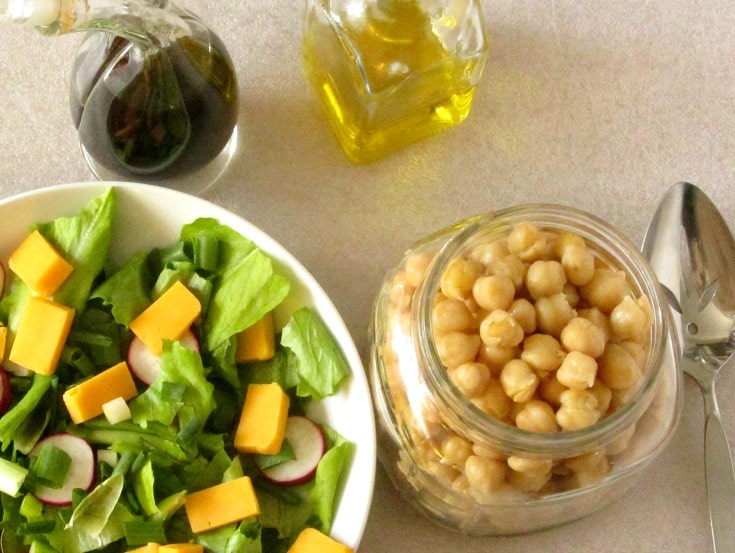 Marinate chickpeas for a flavorful addition to a salad. This easy recipe takes only five minutes, but adds so much to your meal!