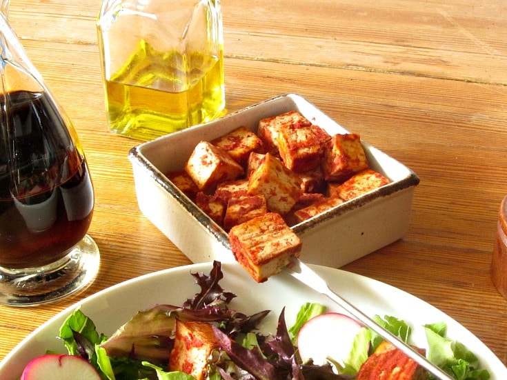 It's easy to season and bake tofu, which is delicious in salad or other recipes. No need to buy the packaged product, this suits your own taste!