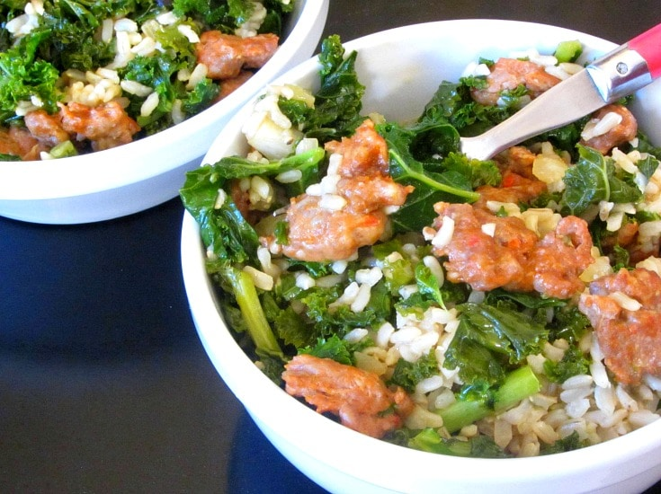 Italian Sausage and Kale come together in a rice bowl for a quick and easy, but hearty and delicious, skillet meal!