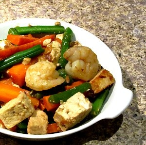 Saute shrimp and tofu with matchstick vegetables, then add just enough sauce to coat for a delicious, but simple, dinner.