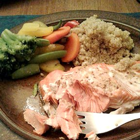 Roast salmon with mustard glaze, with mixed vegetables and quinoa