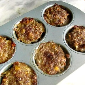 Sausage Meatloaf Muffins in muffin tin.