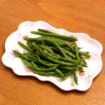 A plate with Garlic Green Beans.