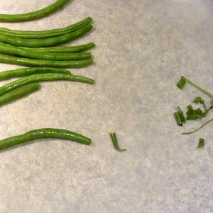 Trim fresh green beans.
