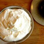 A serving bowl of Roasted Garlic Whipped Feta
