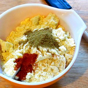 Mixing bowl with cornbread mix and spices
