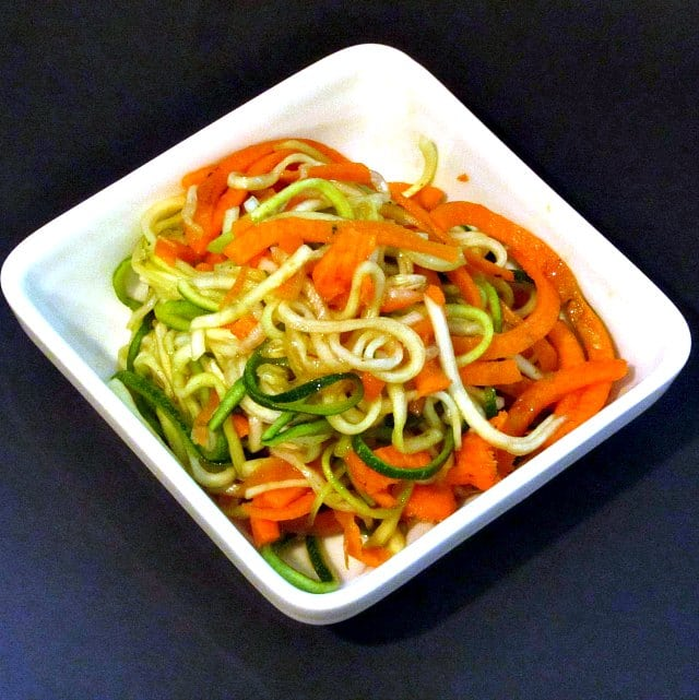 Cut long strands of vegetables with a spiralizer and toss them into a simple Spiralized Salad - tender-crisp, fresh, and easy to eat!