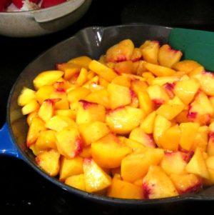 Pan full of peeled and chopped peaches