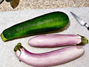 Zucchini and eggplant on a cutting board